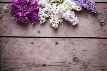 Lilac flowers on wooden background.