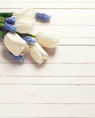 Flowers on wooden backgrouund.