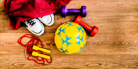 sport equipment, rope, fitness, ball, sports, towel, sneakers, wooden floor, running shoes, sports dumbbells, sport stuff