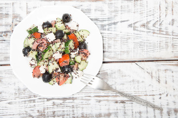 Fresh salad with black quinoa, tomatoes, cucumbers and feta chee