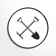 Shovel and a rake. Vector icon.