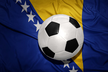 black and white football ball on the national flag of bosnia and herzegovina