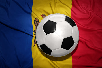 black and white football ball on the national flag of moldova