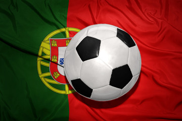 black and white football ball on the national flag of portugal