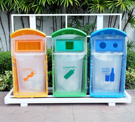 classify bins for recycle,Thai Language yellow is general waste,green is plastic bottle,blue is can and glass bottles...