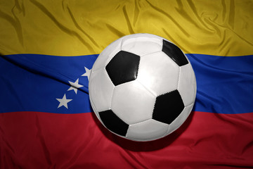 black and white football ball on the national flag of venezuela