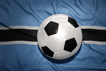 black and white football ball on the national flag of botswana