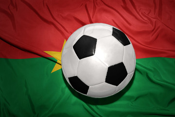 black and white football ball on the national flag of burkina faso