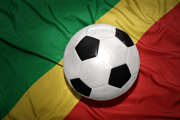 black and white football ball on the national flag of republic congo