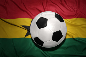 black and white football ball on the national flag of ghana