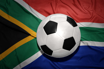 black and white football ball on the national flag of south africa