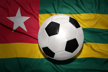 black and white football ball on the national flag of togo