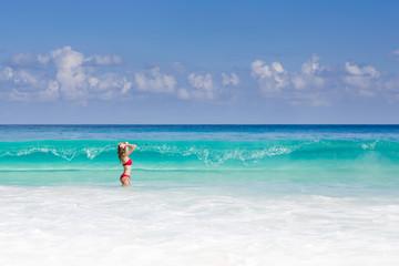 Beautiful and sexy blonde woman in red bikini, turquise sea