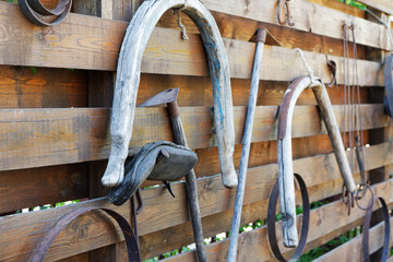 old garden tools and animal-drawn on a wooden fence