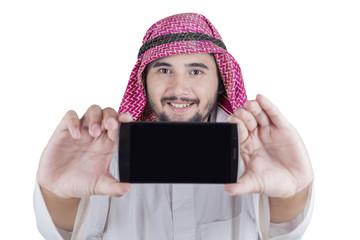Arabian man photographing himself