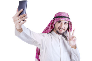 Arabian person taking selfie photo