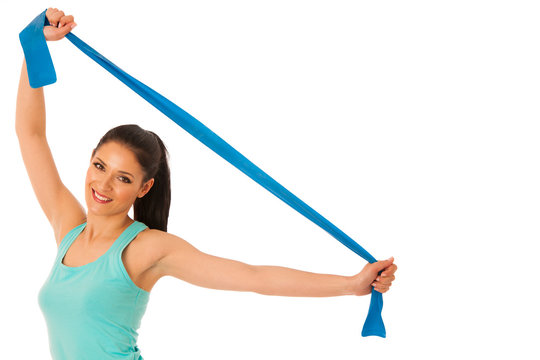 Woman working out with band in fitness gym isolated over white