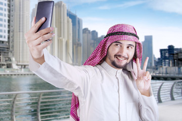 Arabic person taking selfie in the city