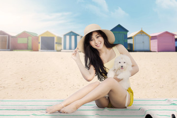 Beautiful girl with maltese dog