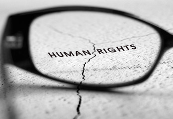 Human rights  text through reading glasses.