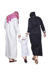 Muslim family walking in the studio