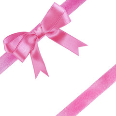 Pink diagonal ribbons and bow, isolated on white