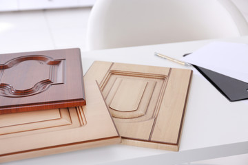 Samples of wooden panels for furniture and door on white table