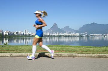 Athletic woman jogging at Lagoa Rodrigo de Freitas lagoon, Rio de Janeiro, Brazil