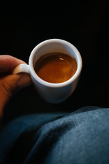 Close-up of hands holding a cup of coffee