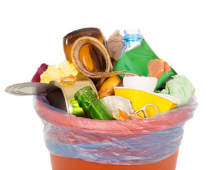 Bin completely filled with household waste isolated on white