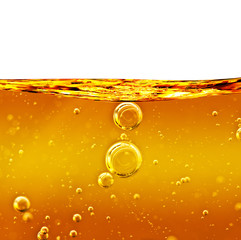 Oil background yellow liquid with air bubbles.