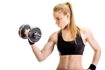 Young slim strong muscular woman posing in studio