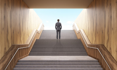 Businessman climbing stairs