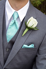 male tie and rose boutonniere for wedding jacket
