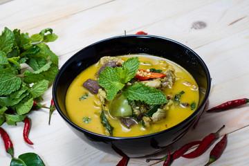 Thai chicken green curry on wooden background
