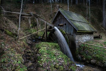 Old Slovenian watermill in the forrest