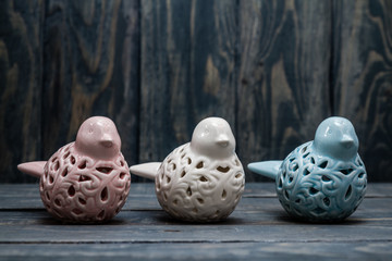 Statuettes of White, Blue and Pink Birds