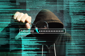 Hooded computer hacker with magnifying glass stealing internet p