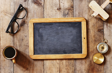 blank blackboard on wooden table. Top view