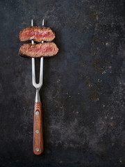 Steak on meat fork