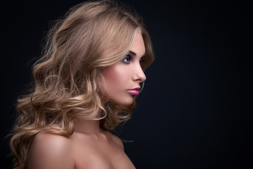 Blonde woman with curly hair