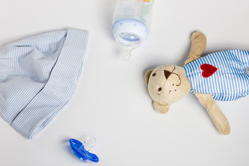 A baby hat, toys, pacifier on a white background.