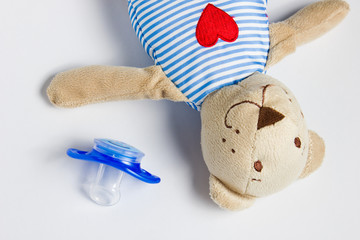 Toy Bear and dummy lying on a white background.