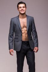 Handsome man in suit on  torso on grey background