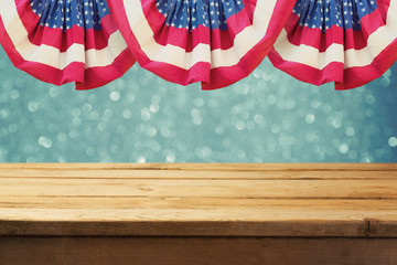 Independence day of America patriotic background with empty wooden table over USA flag. Memorial day background