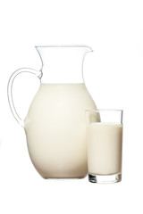 the big jug and glass of fresh milk