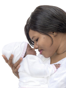 Mother smiling to her one-month-old baby girl, isolated