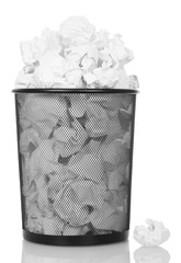 Overflowing metal trash bin from paper isolated on white.