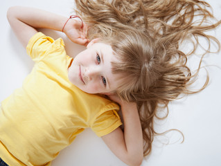 Portrait of a smiling girl lying on the floor