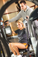 Woman relaxing and exercising at the gym.Fitness instructor.